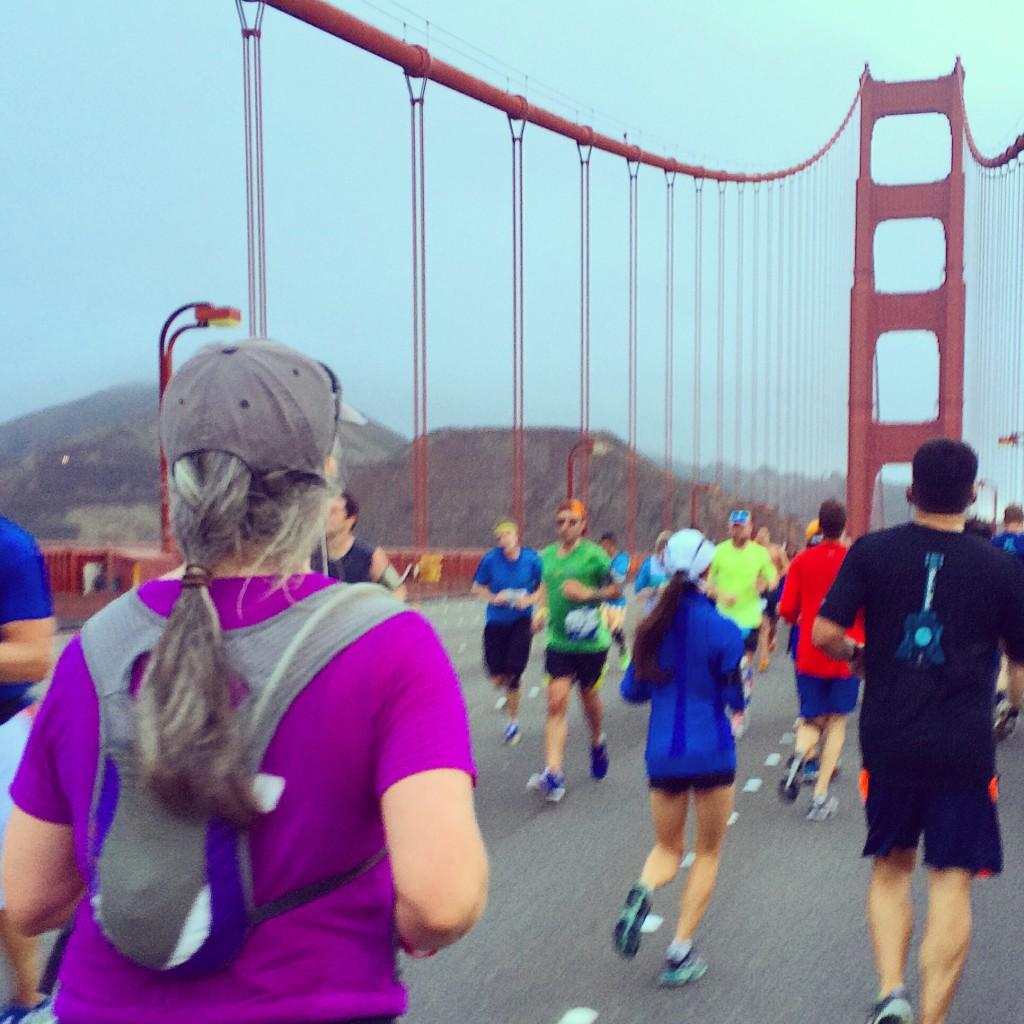Lisa crossing the bridge at mile 5ish